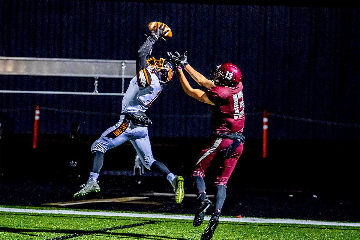 Roseburgs' Garrett Russell (#1) makes the interception against Willamette's Bryce Goggin (#13). The Roseburg Indians defeated the Willamette Wolverines 21-20 at Willamette on Friday. Photo by August Frank, Oregon News Lab