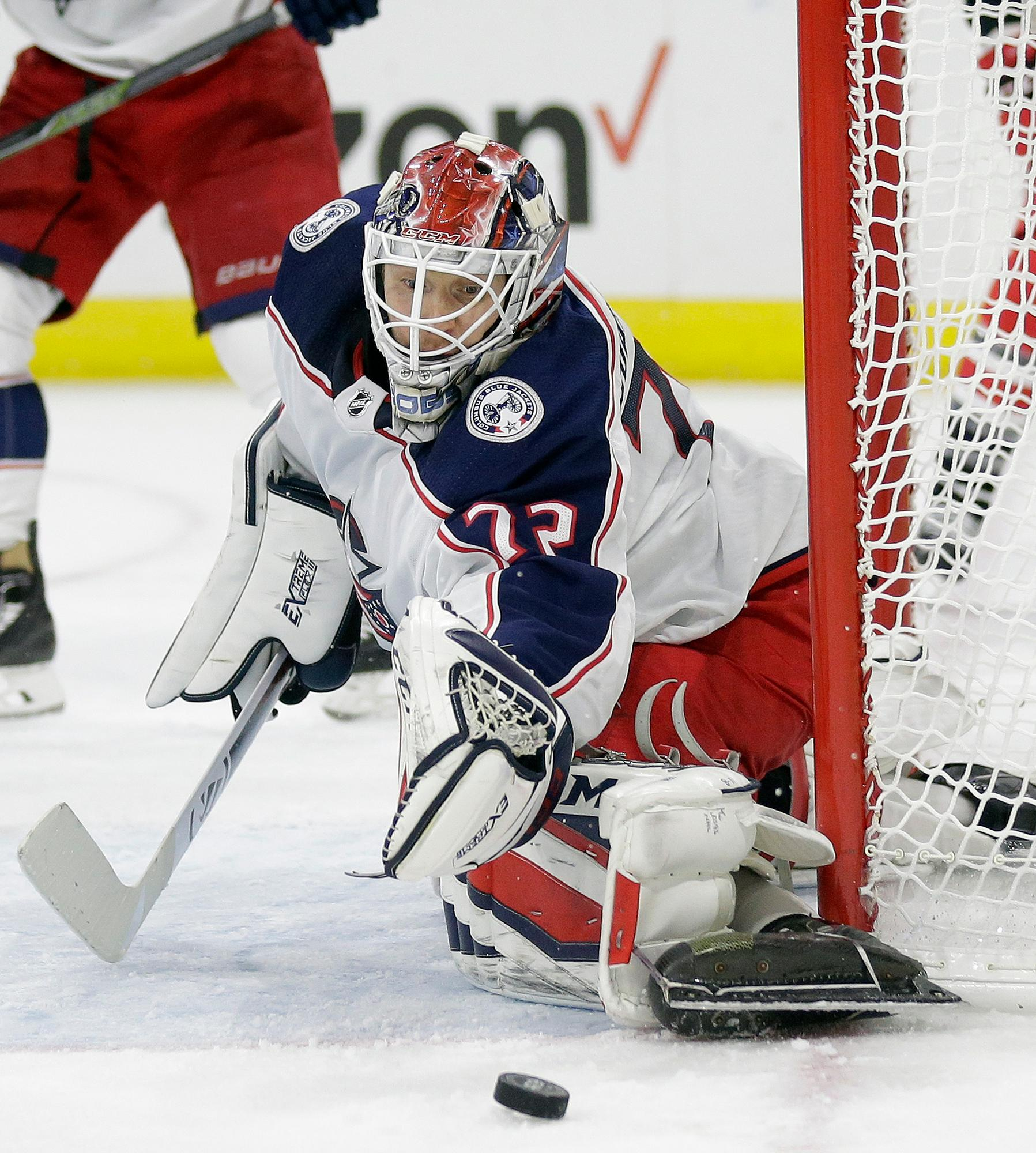 Columbus Blue Jackets goalie Sergei Bobrovsky (72), of Russia, defends the goal during the second period of an NHL hockey game against the Carolina Hurricanes in Raleigh, N.C., Tuesday, Oct. 10, 2017. (AP Photo/Gerry Broome)