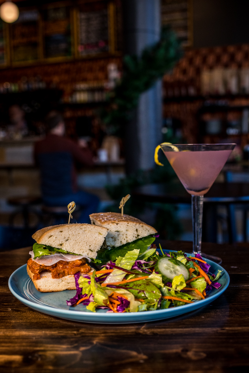 The Spicy Korean Pork Belly sandwich and a Cosmopolitan / Image: Catherine Viox{ }// Published: 1.8.20