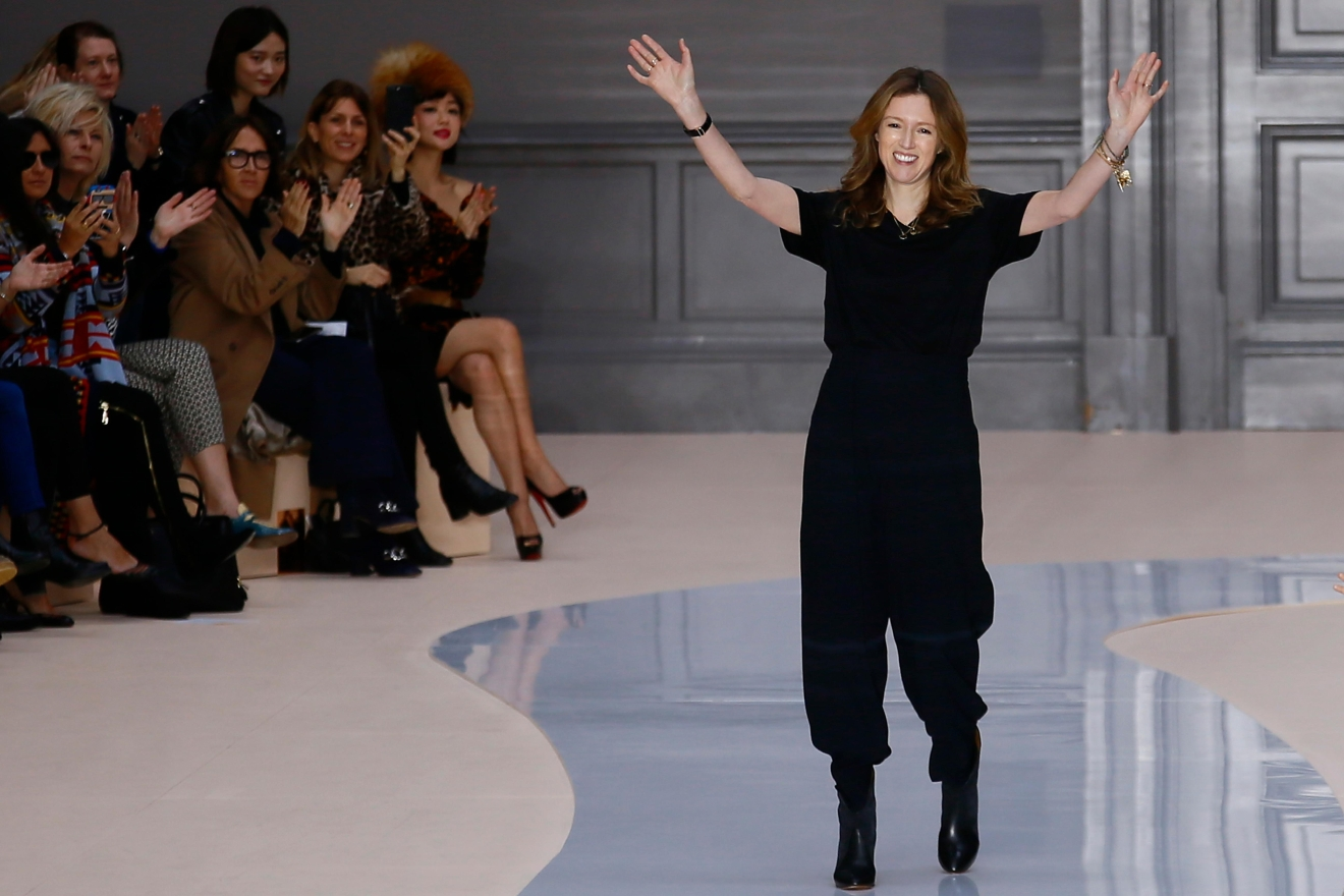 Fashion designer Clare Waight Keller acknowledges applause at the end of the presentation of Chloe's Fall-Winter 2017-2018 ready to wear fashion collection presented in Paris, Thursday, March 2, 2017. (AP Photo/Francois Mori)