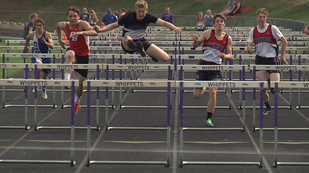 Marshall Chasek (center) of Minden has a slight lead in the 110 M hurdles at the Marsh Beck Invite in Minden, April 13, 2017.  He won the race with a 17.1 second time (NTV News)
