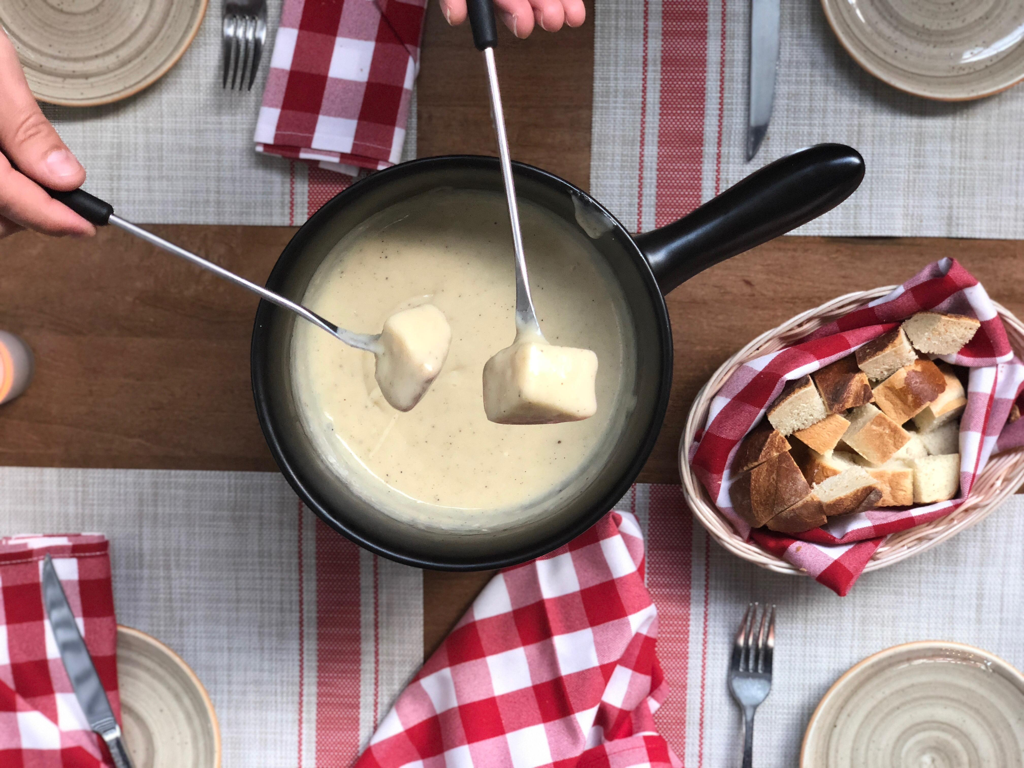 "<p>Last but not least, of course DC's Swiss restaurant offers this après ski staple. Stable makes three versions—a traditional Swiss cheese fondue using a blend of Schlossberger Old, Schlossberger Young and Vacherin cheeses cooked with garlic and white wine; a version that also includes dried garlic and black pepper cheese; and one spiked with Poire Williams liqueur. Each requires a two-person minimum for ordering and is served with housemade white bread for dipping. The Swiss-born chef tested many cheese blends before settling on the Schlossberger cheeses produced by a fifth-generation cheese-maker in the Emmental Valley. To find your own perfect blend of cheeses, visit <a  href=""http://cheesesofeurope.com"" target=""_blank"">cheesesofeurope.com</a>{&nbsp;}for tips and recipes.{&nbsp;}(Image: Courtesy Stable)</p>"