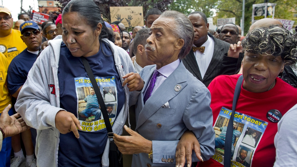 Esaw Garner, left, arrives at the spot where her husband Eric Garner died with The Rev. Al Sharpton, center, and Eric Garner's mother Gwen Carr, right, at the start of a march and rally in the Staten Island borough of New York Saturday, Aug. 23, 2014. The city medical examiner ruled that Eric Garner, 43, died as a result of a police chokehold during an attempted arrest. (AP Photo/Craig Ruttle)