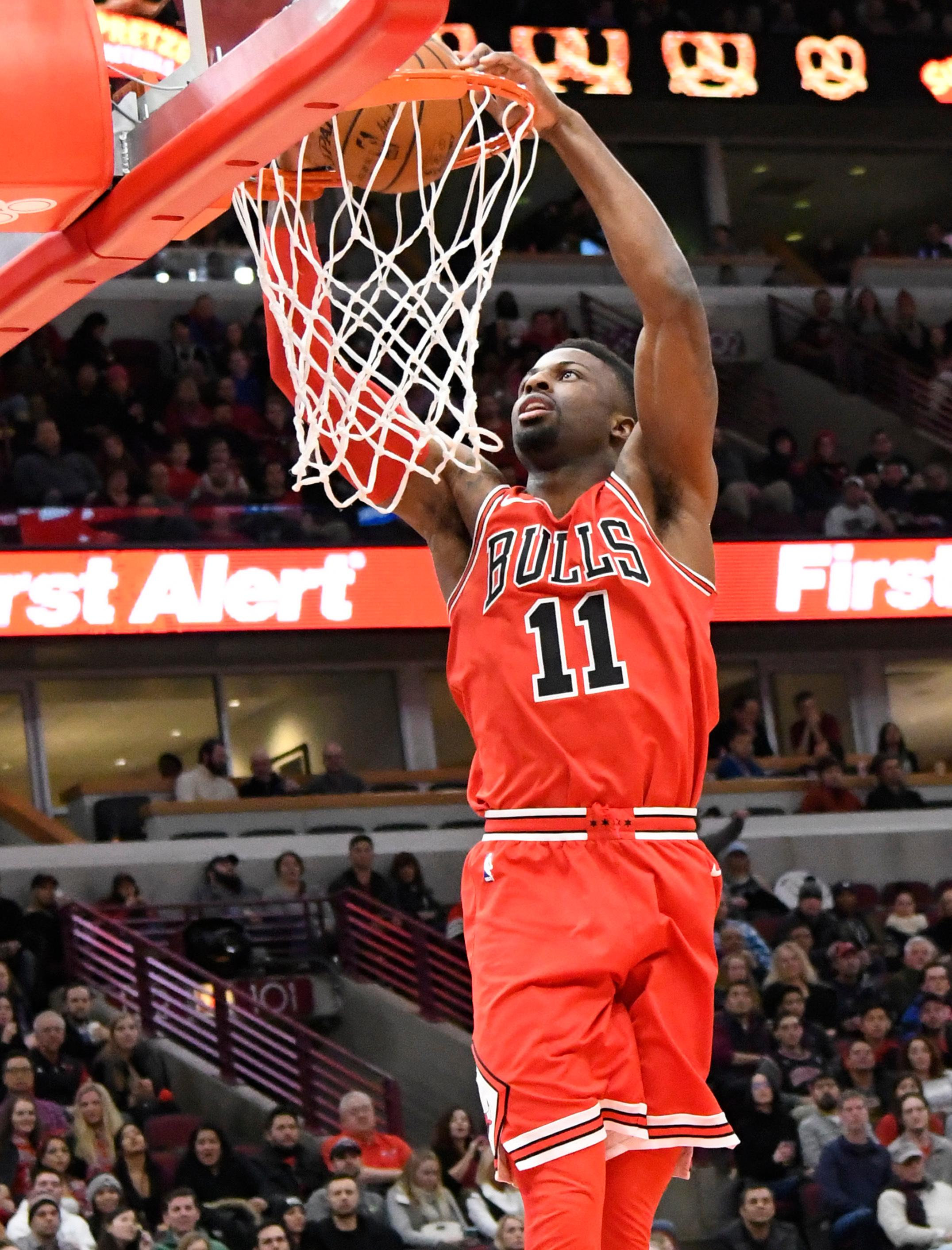 Chicago Bulls guard David Nwaba (11) dunks the ball against the Portland Trail Blazers during the first half of an NBA basketball game, Monday, Jan. 1, 2018, in Chicago. (AP Photo/David Banks)