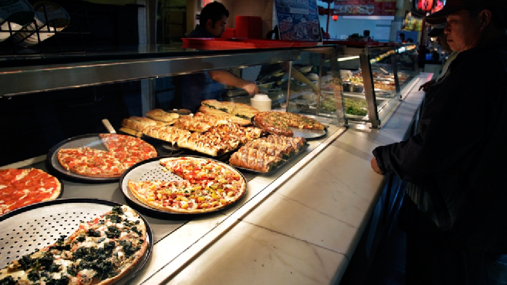 FILE - In this April 4, 2011, file photo, a customer looks at pizzas at Sbarro restaurant in San Jose, Calif. Sbarro said Monday, March 10, 2014, that it is filing for Chapter 11 reorganization, the struggling pizza chain's second trip through bankruptcy court in less than three years. (AP Photo/Paul Sakuma, File)