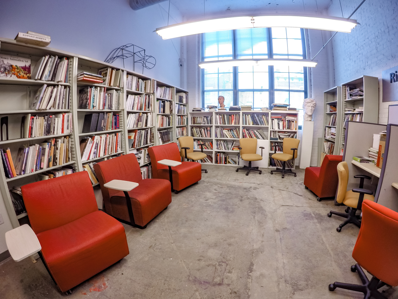 Art students need a place to congregate and a place of solitude. This quiet study space is cozy yet well lit. The official library of the Art Academy is the main Hamilton County library on Vine Street. / Image: Phil Armstrong, Cincinnati Refined // Published: 2.16.17