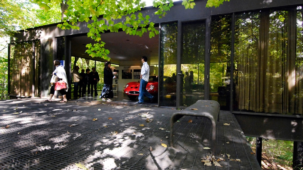 "This Oct. 4, 2009 photo shows visitors touring the pavilion in the back of the modernist home in Highland Park, Ill., that was featured in the movie ""Ferris Bueller's Day Off."" The home, where Ferris Bueller's friend Cameron famously ""killed"" his father's prized Ferrari, sold Thursday, May 29, 2014 for $1.06 million. The house, built in 1953 by Mies van der Rohe-protege A. James Speyer, was first put on the market in 2009 listed at $2.3 million. (AP Photo/Sun-Times Media, Eric Davis)"