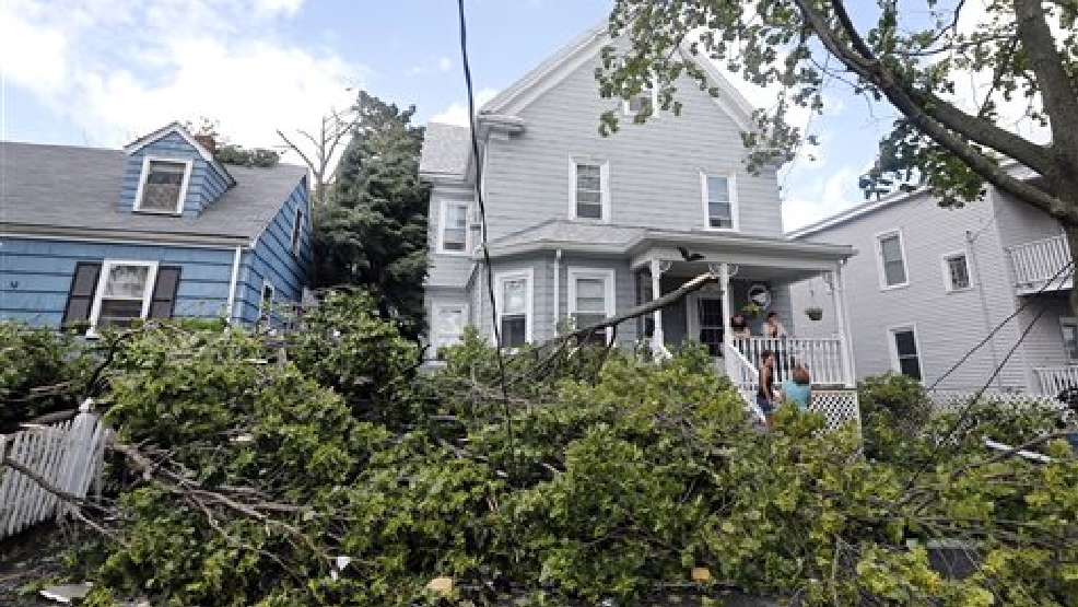 Downed trees and power lines lay in front of homes in Revere, Mass., Monday, July 28, 2014 after a tornado touched down. Revere Deputy Fire Chief Mike Viviano says the fire department has received dozens of calls reporting partial building and roof collapses. (AP Photo/Elise Amendola)