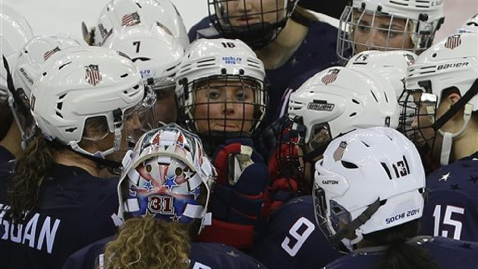Team USA gathers at mid ice after defeating Sweden 6-1 during a 2014 Winter Olympics women's semifinal ice hockey game at Shayba Arena, Monday, Feb. 17, 2014, in Sochi, Russia. (AP Photo/Matt Slocum)