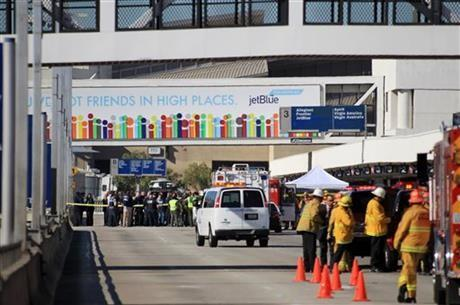 Fire, rescue and police personnel gather at the Los Angeles International Airport on Friday Nov.1, 2013.