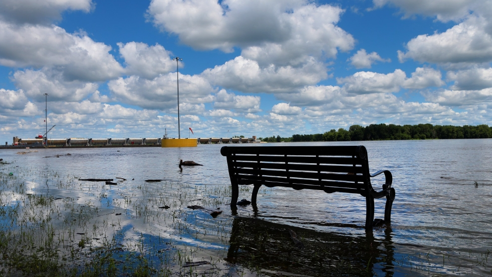 The Mississippi River overtakes a bench at the Riverfront Park in Clarksville, Mo., Thursday, July 3, 2014, as Mississippi River floodwater threatens the town. (AP Photo/St. Louis Post-Dispatch, Robert Cohen)