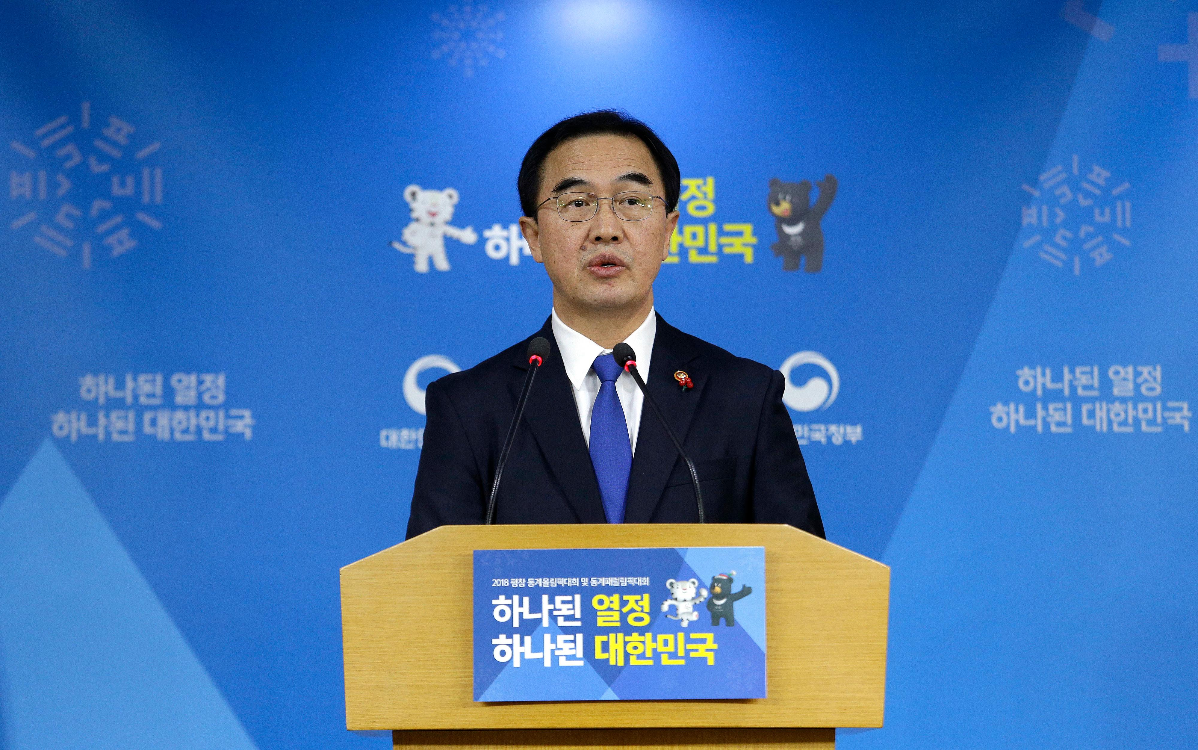 "South Korean Unification Minster Cho Myoung-gyon speaks during a press conference at the government complex in Seoul, South Korea, Tuesday, Jan. 2, 2018. Cho on Tuesday offered high-level talks with rival North Korea meant to find ways to cooperate on the Winter Olympics set to begin in the South next month. The banner showing the 2018 Pyeongchang Winter Olympic slogan reads: ""Passion. Connected."" (AP Photo/Ahn Young-joon)"