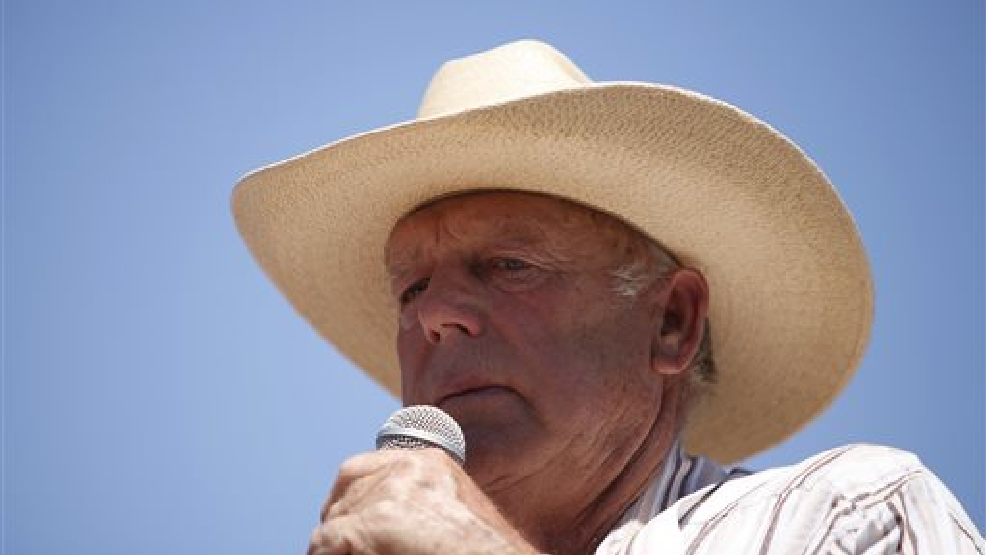 In this April 24, 2014, file photo, rancher Cliven Bundy speaks at a news conference near Bunkerville, Nev. U.S. Bureau of Land Management officials say they agree with a Nevada sheriff's position that rancher Bundy must be held accountable for his role in an April standoff between his supporters and the federal agency. Clark County Sheriff Doug Gillespie said Bundy crossed the line when he allowed states' rights supporters, including self-proclaimed militia members, onto his property to aim guns at police. (AP Photo/Las Vegas Review-Journal, John Locher, File)