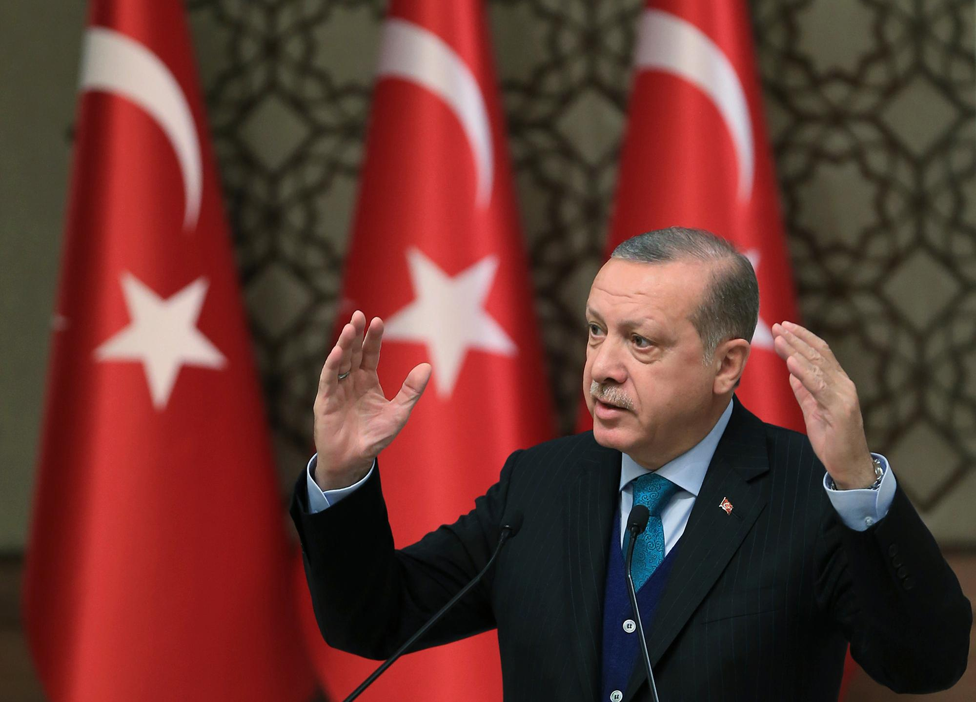 "Turkey's President Recep Tayyip Erdogan, gestures as he delivers a speech at an event in Ankara, Turkey, Tuesday, Dec. 12, 2017. Leaders and high-ranking officials of Muslim countries will meet Wednesday Dec. 13, in Istanbul for an extraordinary summit to discuss the U.S. recognition of Jerusalem as Israel's capital. Erdogan has been vehemently critical of the U.S. move and said the leaders would relay a ""strong message."" (Pool Photo via AP)"