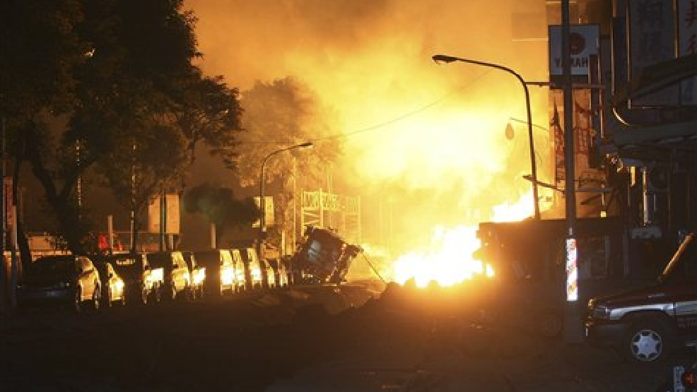 Flames from an explosion from an underground gas leak in the streets of Kaohsiung, Taiwan, early Friday, Aug. 1, 2014. A massive gas leakage early Friday caused five explosions that killed several people and injured over 200 in the southern Taiwan port city of Kaohsiung. (AP Photo)