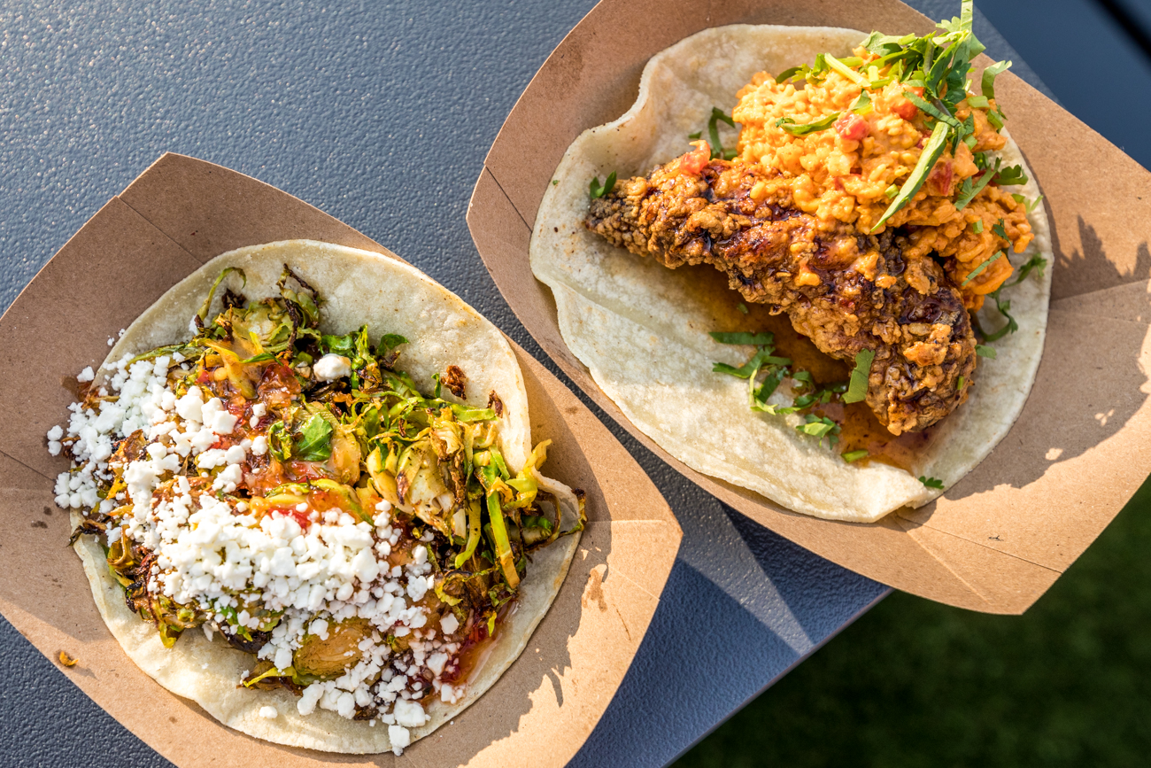 The Fried Chicken Taco (buttermilk fried chicken, house pimento cheese, and chipotle honey) and the Brussel Sprout Taco (brussel sprouts, sesame chili oil, chili garlic, and goat cheese) and chips with guacamole from Django Western Taco / Image: Catherine Viox // Published: 10.15.20