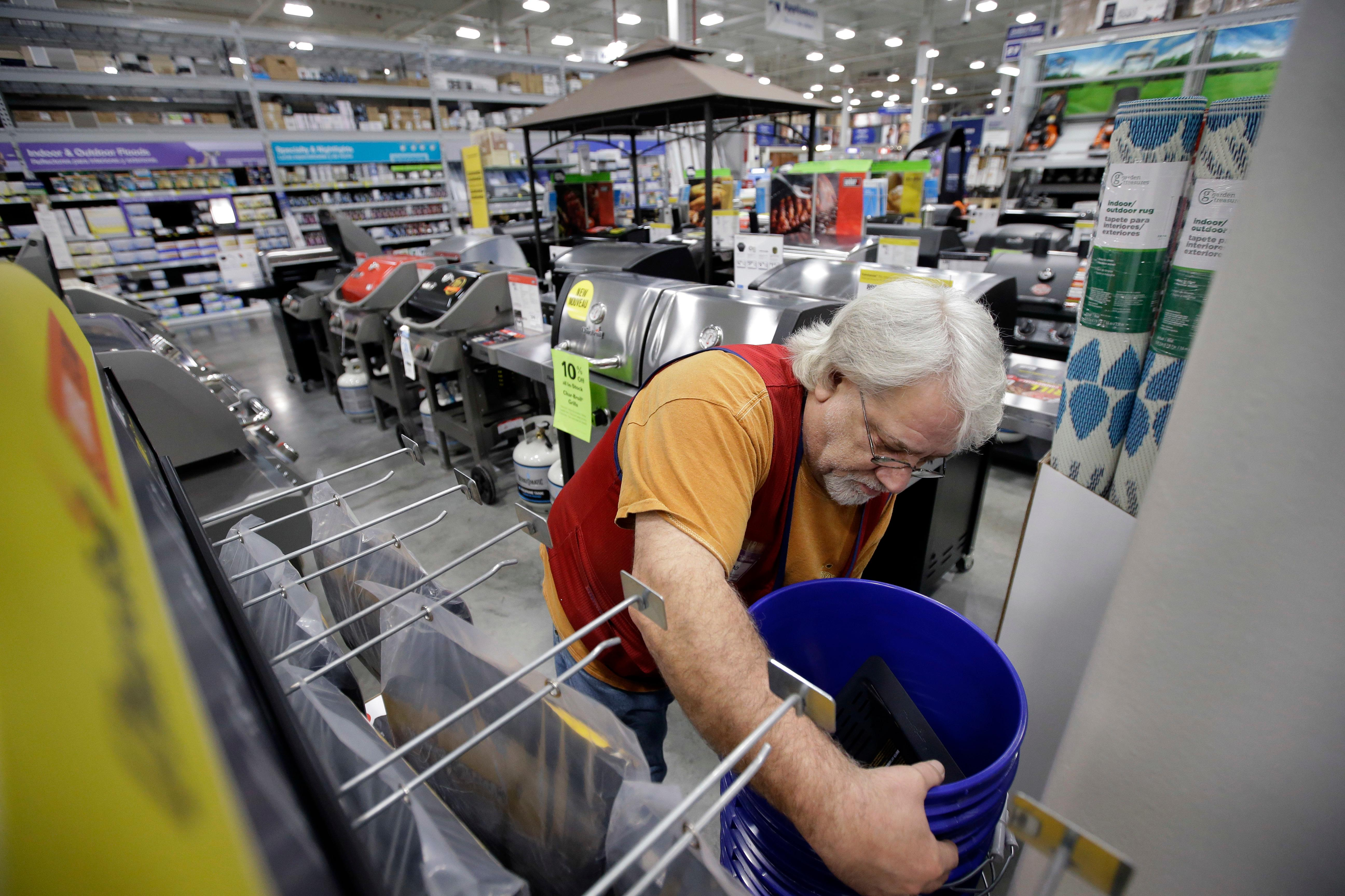 FILE- In this Feb. 23, 2018, file photo sales associate Bob Henriques, of Framingham, Mass., moves items at a Lowe's retail home improvement and appliance store, in Framingham. Lowe's Companies Inc. reports earnings on Wednesday, May 23. (AP Photo/Steven Senne, File)