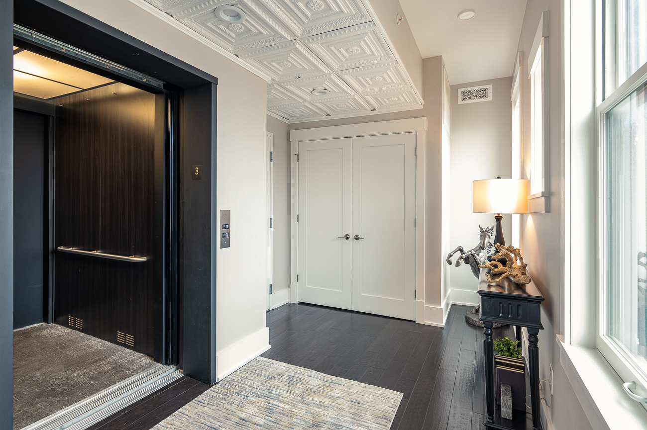 The elevator opens directly into the living area for easy access. / Image: Phil Armstrong // Published: 1.6.21