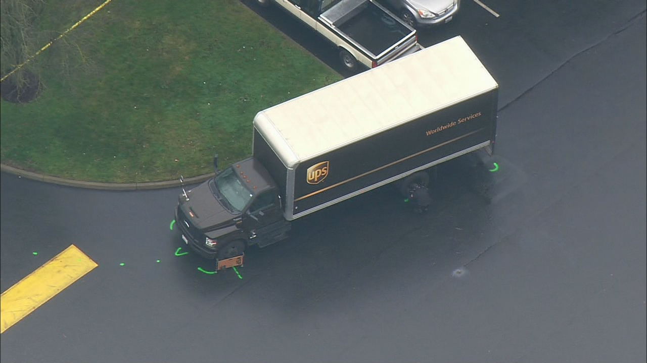 <p>Police investigate a deadly collision between a woman on ascooter and a UPS truck in Auburn (KOMO Photo)</p>