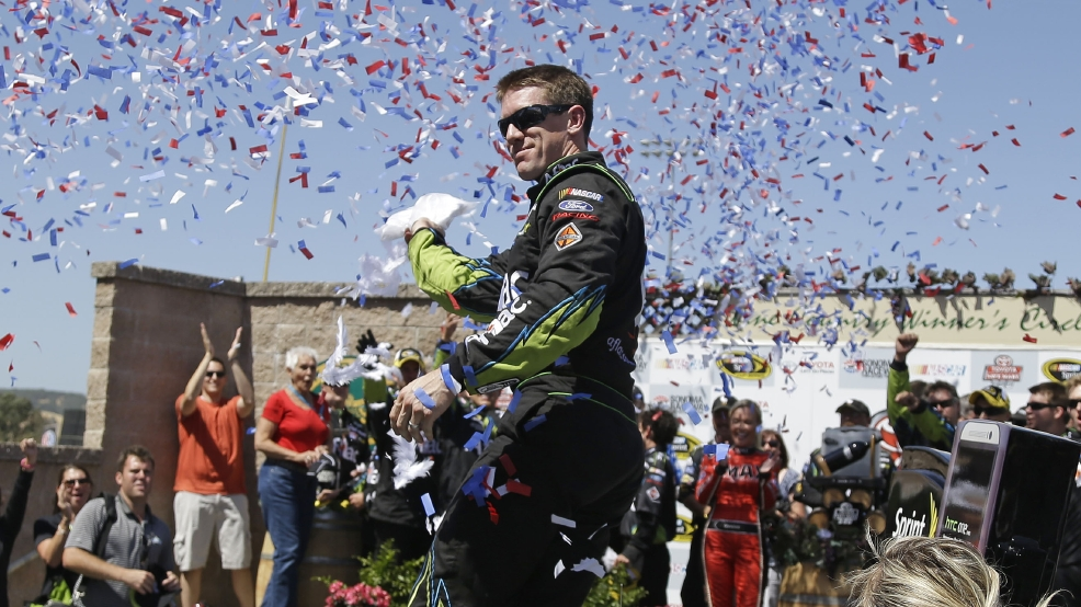 Carl Edwards stands atop his car after winning the NASCAR Sprint Cup Series auto race on Sunday, June 22, 2014, in Sonoma, Calif. Gordon finished in second place. (AP Photo/Eric Risberg)