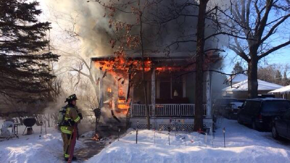 Firefighters battle a house fire on Ruggles Street, Monday, March 3, 2014. (Troy Haase/Fond du Lac Fire Department)