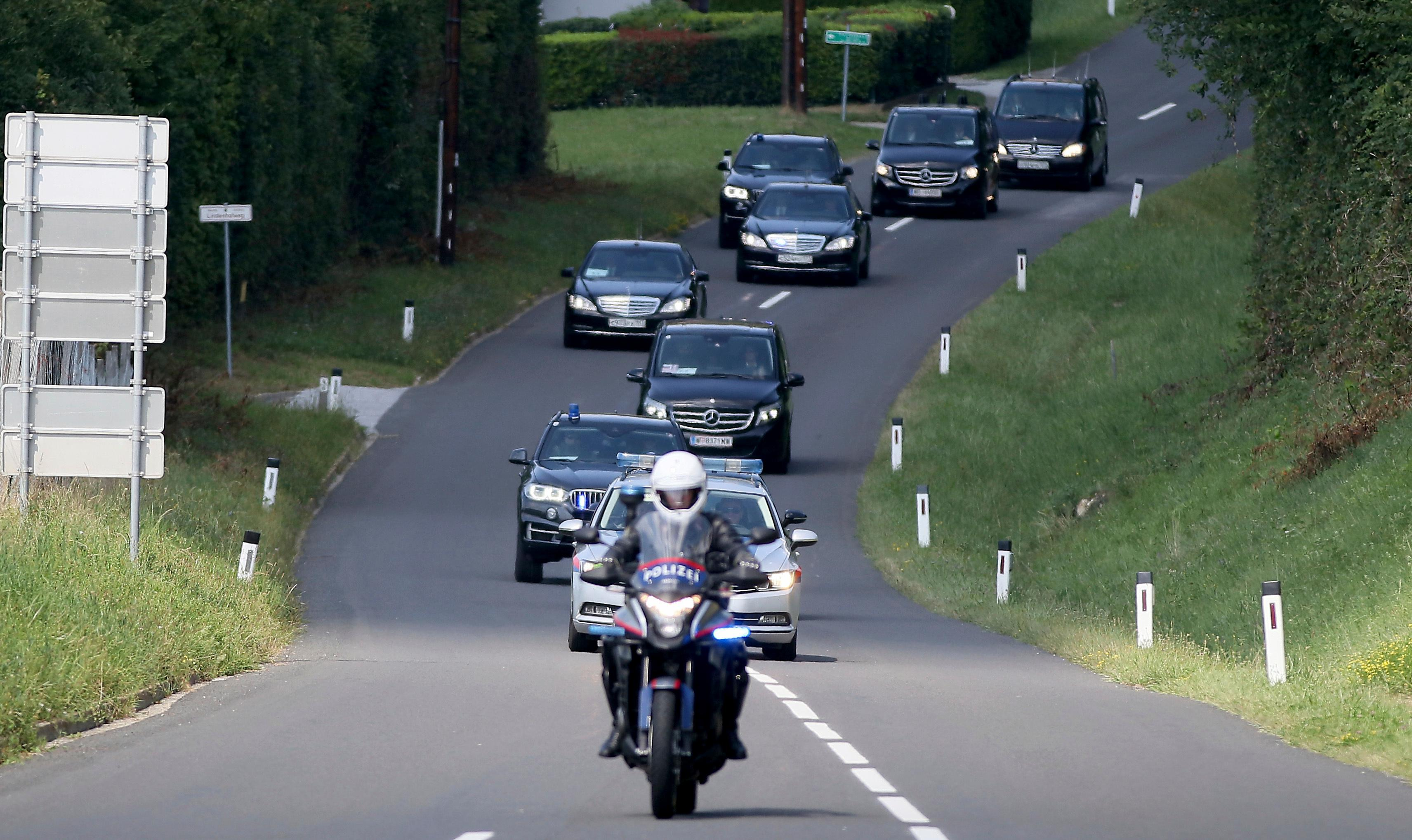 The car convoy of Russia's President Vladimir Putin arrives for the wedding of Austria's Foreign Minister Karin Kneissl and Wolfgang Meilinger Aug. 18. (AP Photo/Ronald Zak)