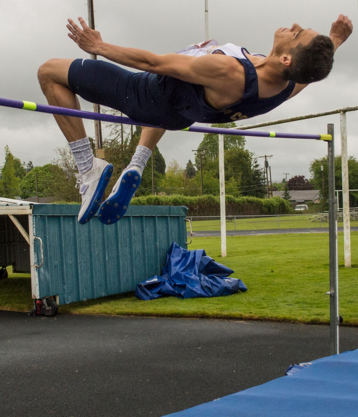 "Pierce Lacoste of Marist High School clears the bar at a height of 6'3"", winning the Men's High Jump event at the 5A-3 Midwestern League District Championship. Photo by Emily Gonzalez, Oregon News Lab."