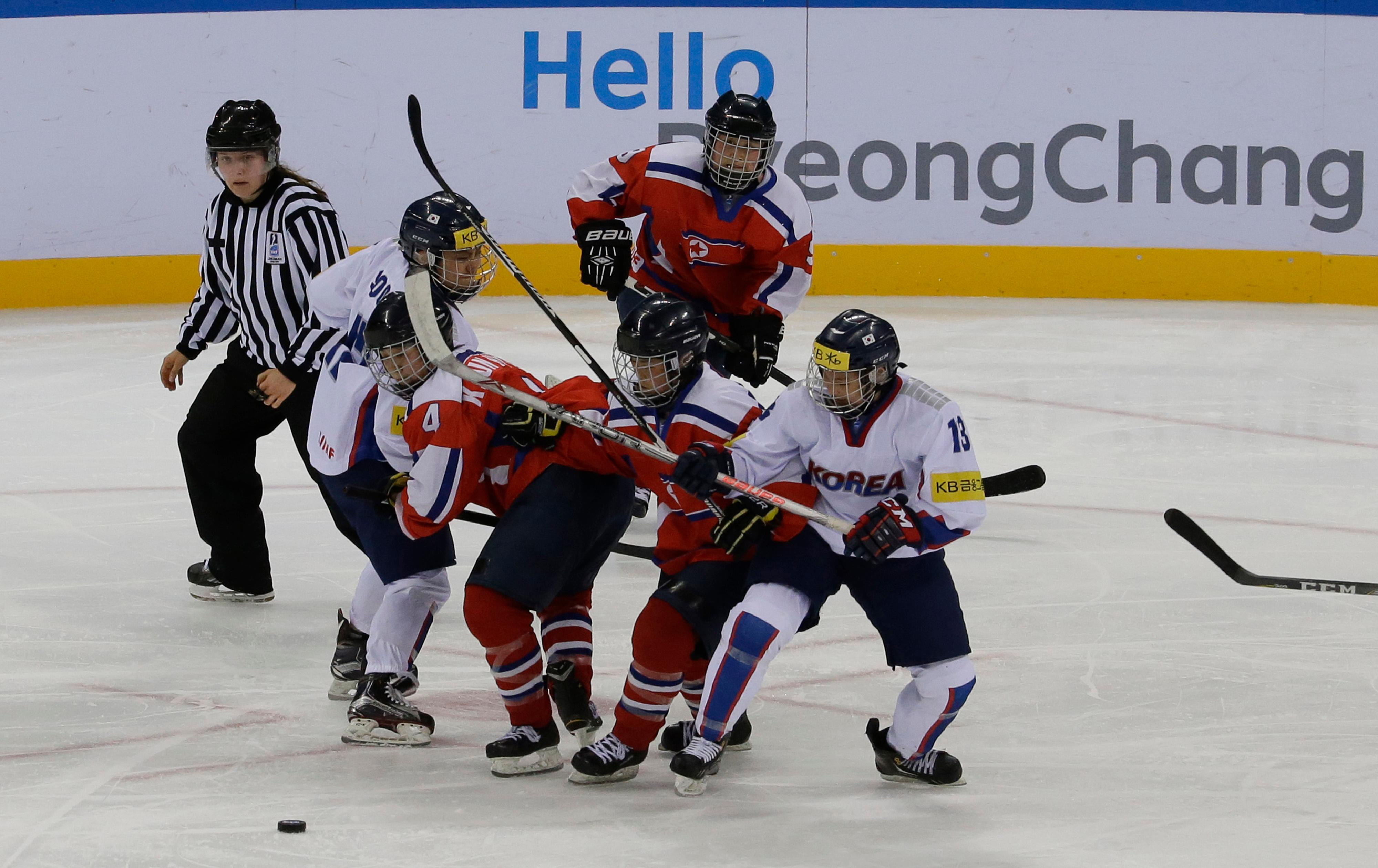 "FILE - In this April 6, 2017 file photo, South, wearing white uniforms, and North Korean players compete during their IIHF Ice Hockey Women's World Championship Division II Group A game in Gangneung, South Korea. During South and North Korea's talks at the border in about a week Wednesday, Jan. 17, 2018, senior officials from the two Koreas reached a package of deals including fielding a joint women's hockey team and conducting a joint march under a ""unification flag"" depicting their peninsula during the opening ceremony, according to Seoul's Unification Ministry. (AP Photo/Ahn Young-joon)"