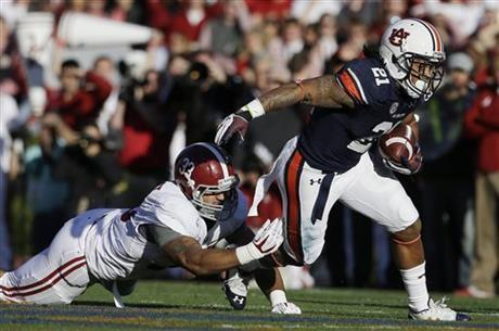 Auburn running back Tre Mason (21) is taken down by Alabama linebacker Trey DePriest (33) during the first half of an NCAA college football game in Auburn, Ala., Saturday, Nov. 30, 2013. (AP Photo/Jay Sailors)