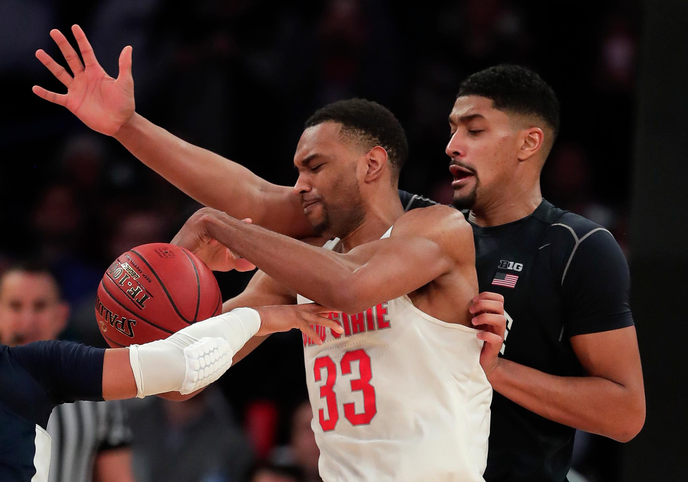 Ohio State forward Keita Bates-Diop (33) is stripped of the ball as he drives against Penn State forward Julian Moore (44) during the second half of an NCAA Big Ten Conference tournament college basketball game, Friday, March 2, 2018, in New York. Penn State won 69-68. (AP Photo/Julie Jacobson)