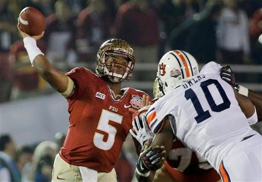 Florida State's Jameis Winston (5) throws during the first half of the NCAA BCS National Championship college football game against Auburn Monday, Jan. 6, 2014, in Pasadena, Calif.