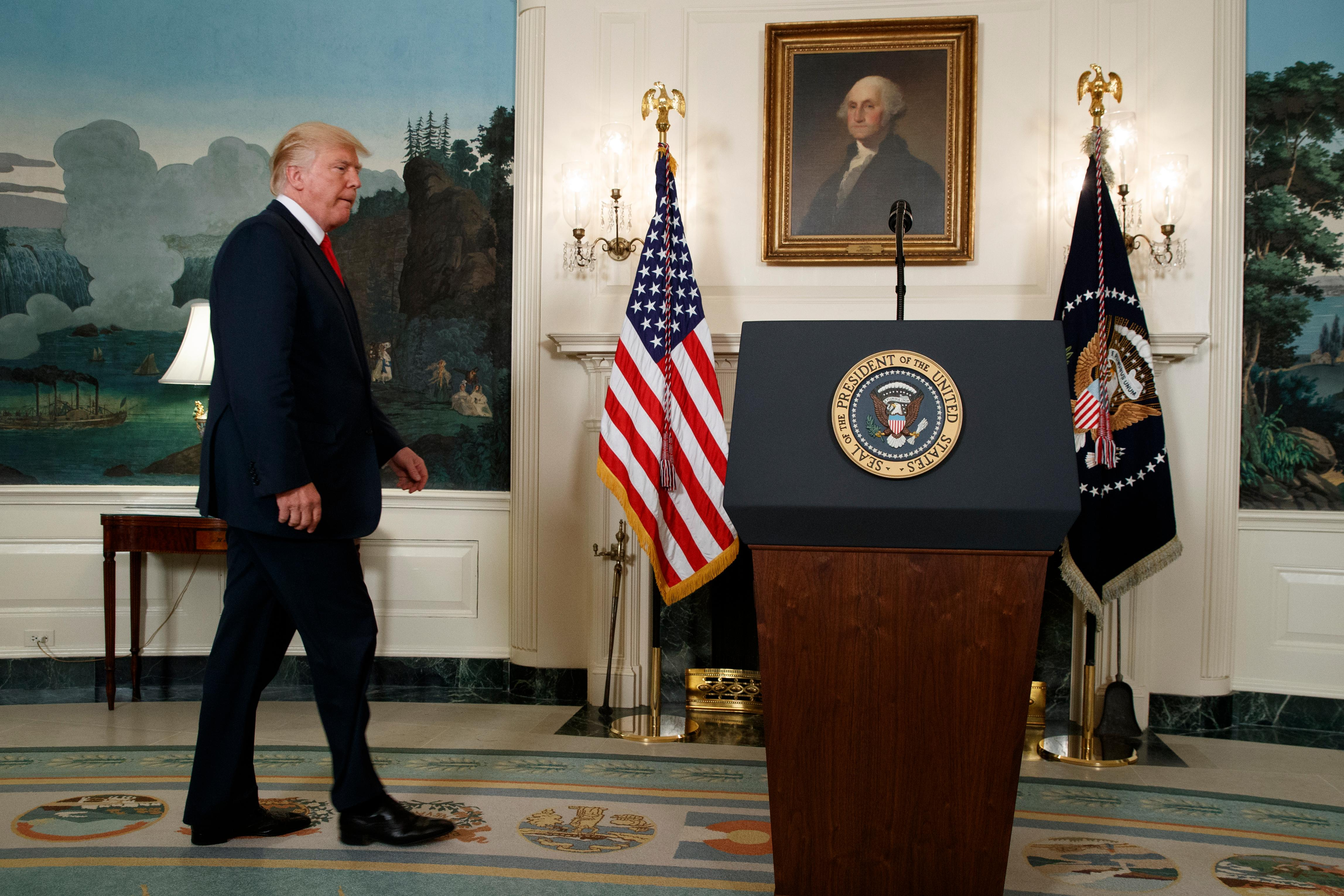 President Donald Trump arrives to speak about the deadly white nationalist rally in Charlottesville, Va., Monday, Aug. 14, 2017, in the Diplomatic Room of the White House in Washington. (AP Photo/Evan Vucci)