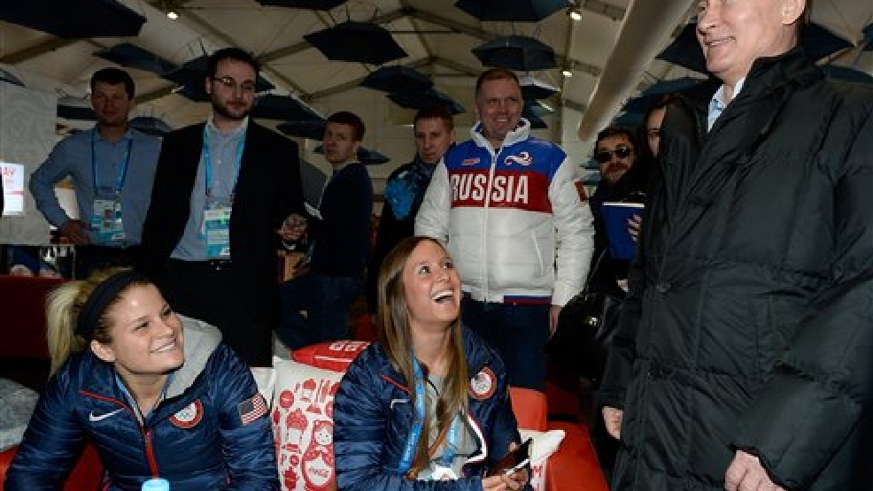 Russian President Vladimir Putin meets with athletes from the United States while visiting the Athletes Village in the Coastal Cluster ahead of the Sochi 2014 Winter Olympics on Wednesday, Feb. 5, 2014, in Sochi, Russia.  (AP Photo/Pascal Le Segretain, Pool)