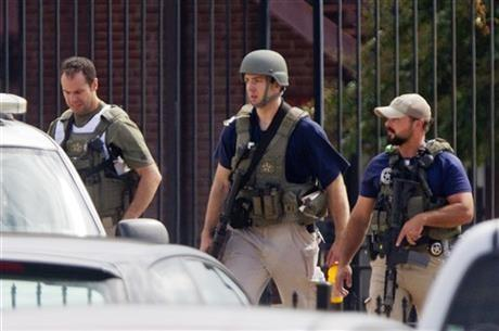 Armed U.S. Marshals leave the scene where a gunman was reported at the Washington Navy Yard in Washington, on Monday
