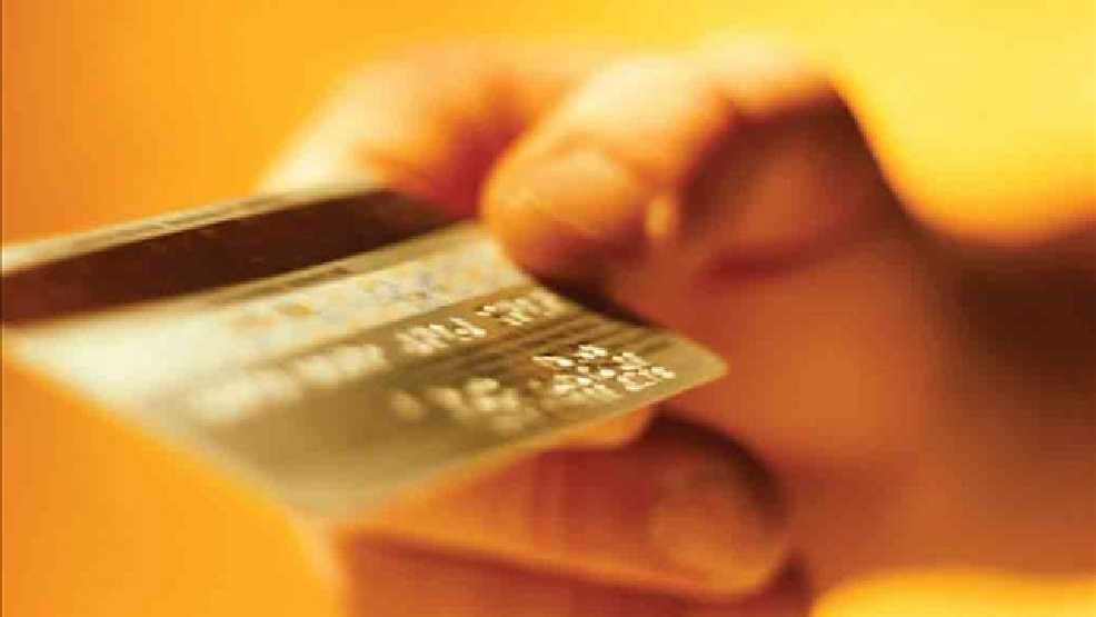 Anonymous hand giving over credit card. (Photo Credit: Courtesy Southern Federal Credit Union)