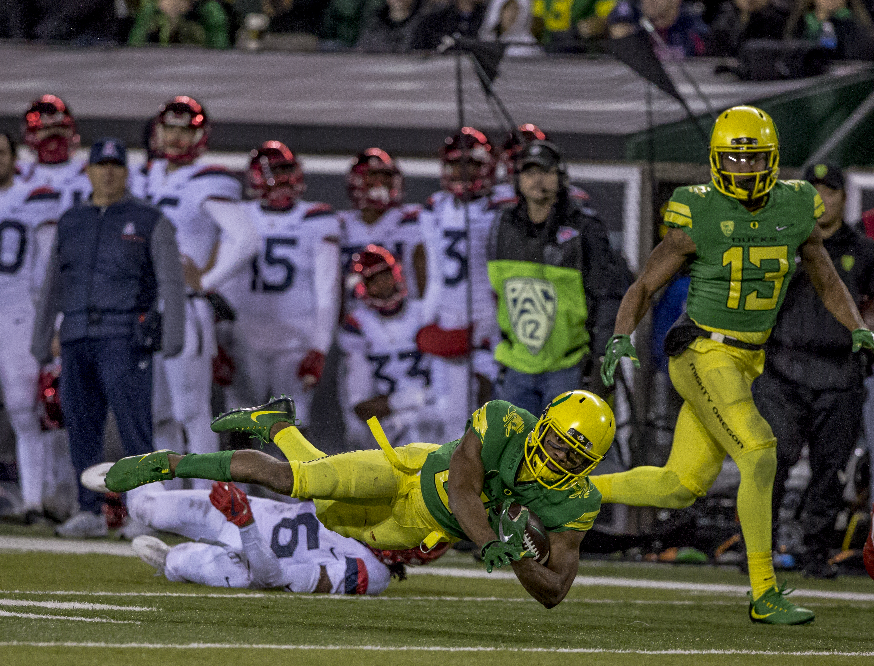 Oregon running back Tony Brooks-James (#20) dives forward with the ball for a first down. The Oregon Ducks defeated the Arizona Wildcats 48 to 28 during a chilly evening game at Autzen Stadium on November 18, 2017. Photo by Ben Lonergan, Oregon News Lab