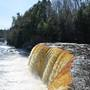 Water flowing at 10,000 gallons per second over Upper Tahquamenon Falls