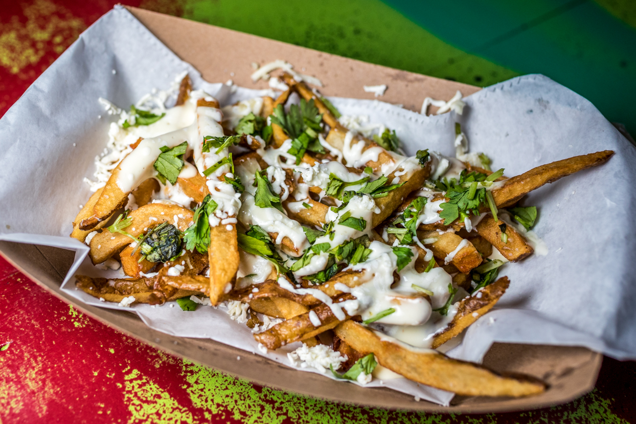 Queso Fritas: salt and pepper french fries, cotija, oaxaca cheese, queso, and cilantro / Image: Catherine Viox{ }// Published: 8.24.20