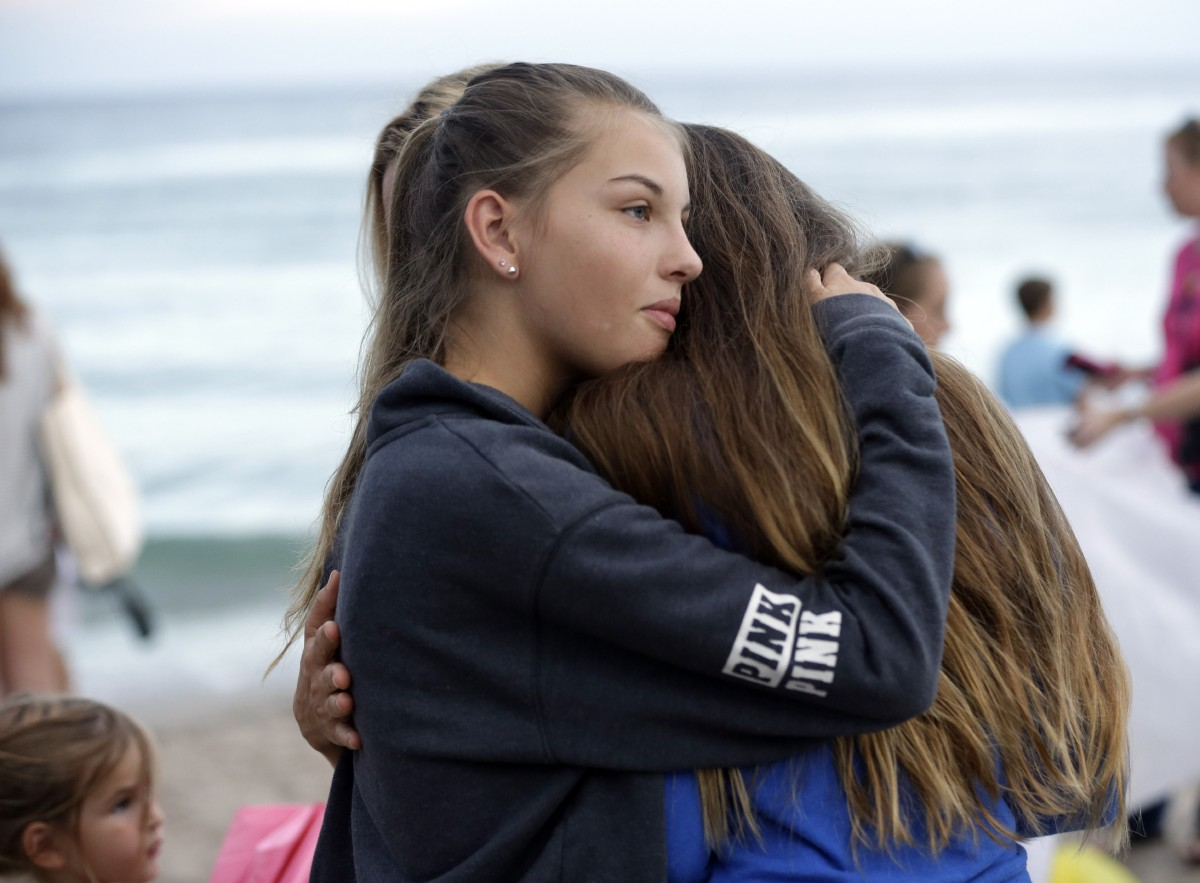 gut wrenching decision search for teens to be suspended wjla two girls embrace during a vigil for austin stephanos and perry cohen tuesday
