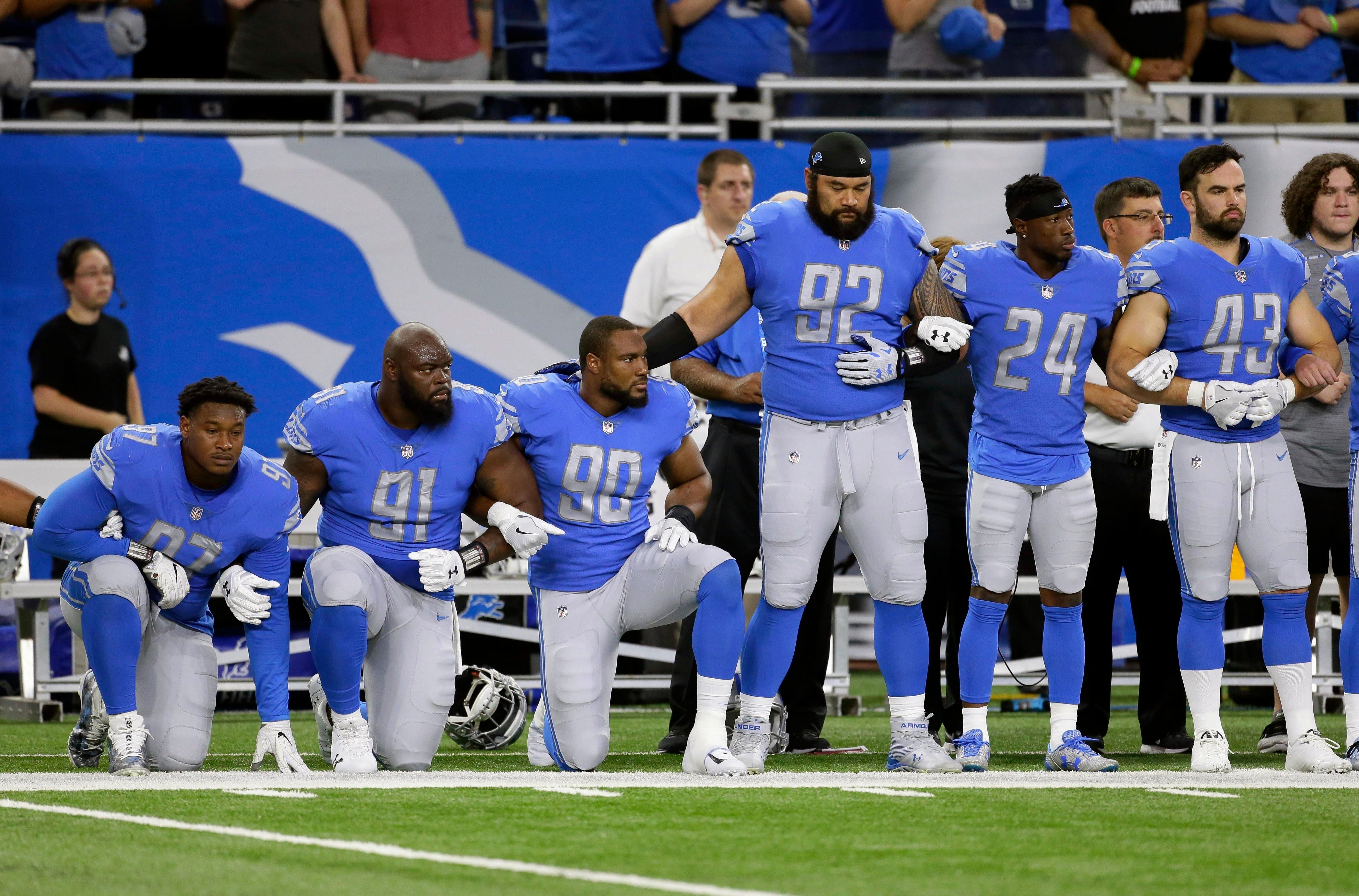 "FILE- In a file photo from Sept. 24, 2017, Detroit Lions defensive end Armonty Bryant (97), defensive tackle A'Shawn Robinson (91) and defensive end Cornelius Washington (90) take a knee during the national anthem before an NFL football game against the Atlanta Falcons, in Detroit. The sight of football players kneeling during the national anthem across the United States is the continuation of a tradition nearly as old the song itself. University of Michigan musicology professor Mark Clague says ""The Star-Spangled Banner"" has been a channel for protest since at least the 1840s. The lyrics were recast as an anti-slavery song and it's been used or reworked to push for racial equality, women's suffrage, prohibition and labor rights. (AP Photo/Duane Burleson, File)"