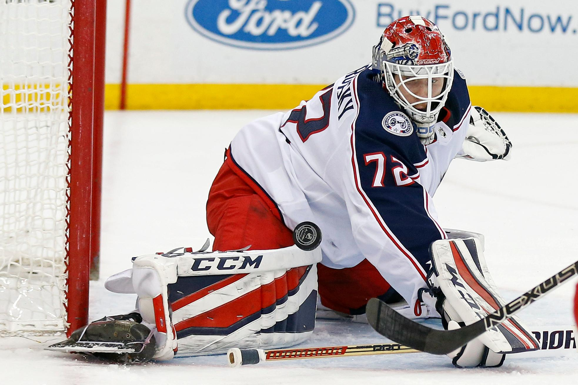 Columbus Blue Jackets goaltender Sergei Bobrovsky (72) makes a save against the New Jersey Devils during the second period of an NHL hockey game Tuesday, Feb. 20, 2018, in Newark, N.J. (AP Photo/Adam Hunger)