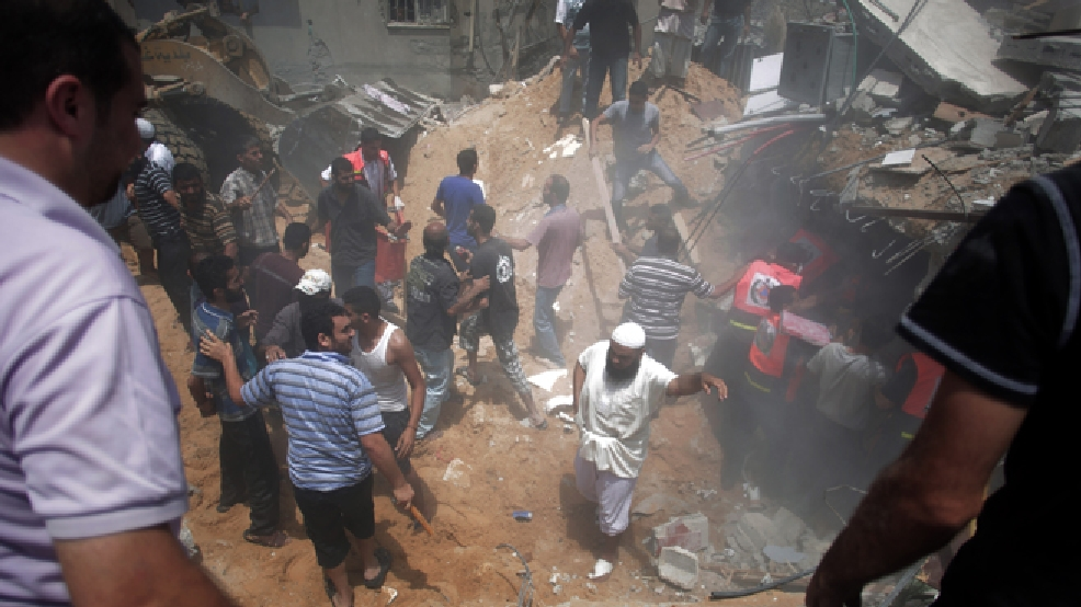 Palestinians search for survivors under the rubble of a house destroyed by an Israeli missile strike, in Gaza City, Monday, July 21, 2014. On Sunday, the first major ground battle in two weeks of Israel-Hamas fighting exacted a steep price, killing scores of Palestinians and over a dozen Israeli soldiers and forcing thousands of terrified Palestinian civilians to flee their devastated Shijaiyah neighborhood, which Israel says is a major source for rocket fire against its civilians. (AP Photo/Khalil Hamra)