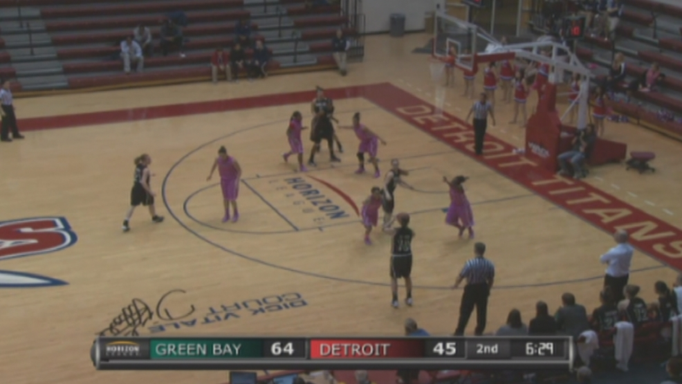 Mehryn Kraker of Green Bay makes one of her seven three pointers against Detroit.
