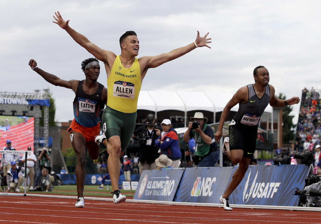 Devon Allen celebrates his win in the finals of the men's 110-meter hurdles at the U.S. Olympic Track and Field Trials, Saturday, July 9, 2016, in Eugene Ore.  (AP Photo/Marcio Jose Sanchez)