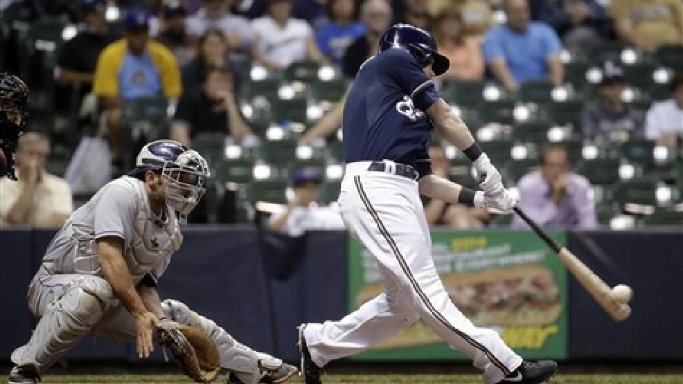 Milwaukee Brewers' Scooter Gennett hits a two-run home run during the eighth inning of a baseball game against the Colorado Rockies on Thursday, June 26, 2014, in Milwaukee. (AP Photo/Morry Gash)