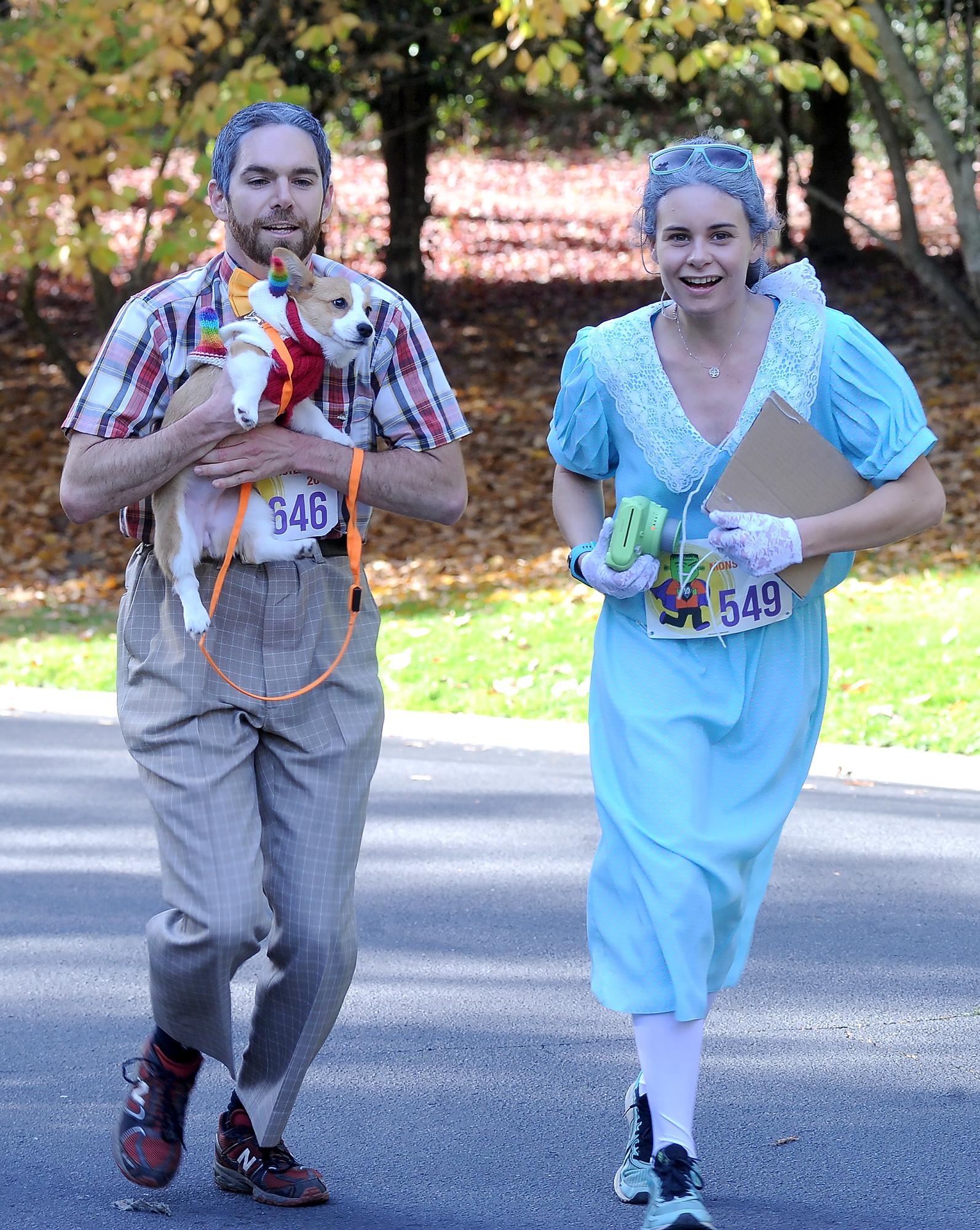 "Reed Bentley and Meghan Murphy run with their dog ""Edison Burphy"" in Saturday's 5k Monster Dash race. Photo by Denise Baratta"
