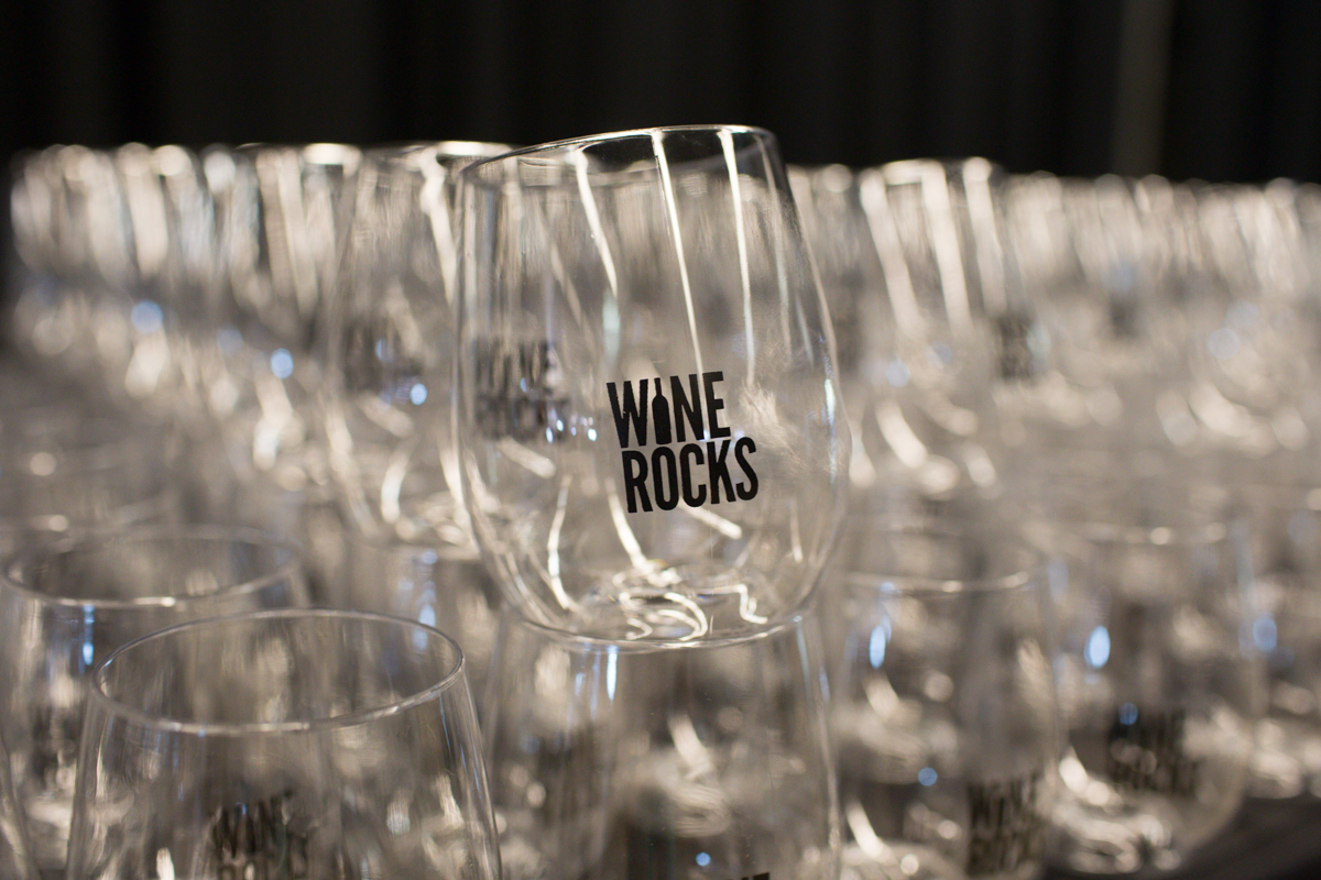 "Folks celebrated at Wine Rocks last night at Pier 66 in Seattle. Wine Rocks is an annual not-for-profit gathering of local winemakers and craft brewers celebrating ""exceptional wine, unique distillates, outstanding beer, groovy tunes, savory fare and one heckuva backdrop."" (Image: Joshua Lewis / Seattle Refined)"
