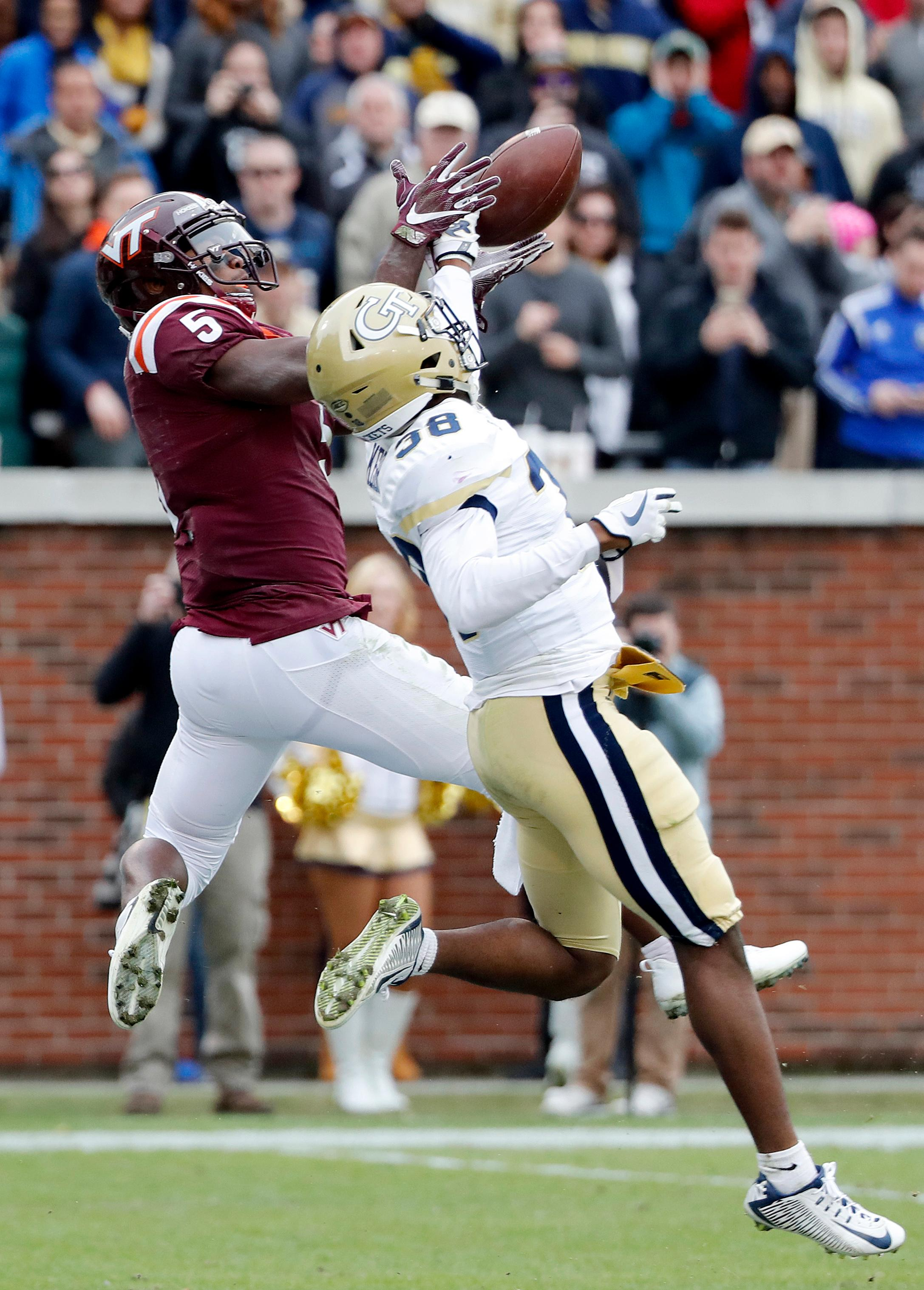 Georgia Tech's Ajani Kerr, right, breaks up a pass intended for Virginia Tech's Cam Phillips late in the fourth quarter of an NCAA college football game in Atlanta, Saturday, Nov. 11, 2017. Georgia Tech won 28-22. (AP Photo/David Goldman)
