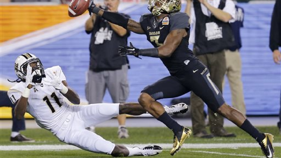 Baylor cornerback Demetri Goodson, right, breaks up a pass intended for Central Florida wide receiver Breshad Perriman during the first half of the Fiesta Bowl NCAA college football game, Wednesday, Jan. 1, 2014, in Glendale, Ariz. (AP Photo/Matt York)