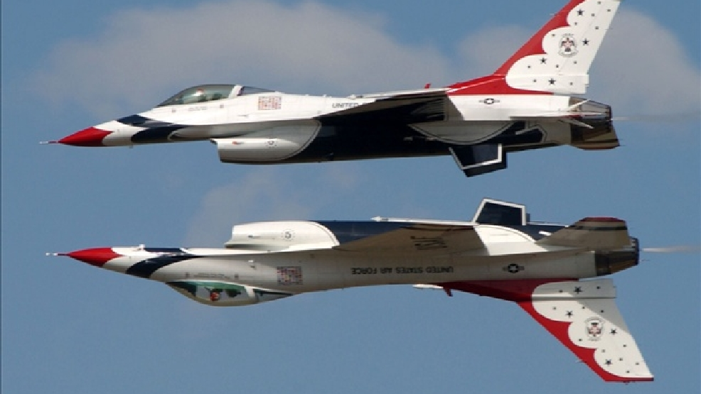 The US Air Force Thunderbirds opposing solos fly mirror formation.  (Photo Credit: MGN Online /  USAF Thunderbirds)